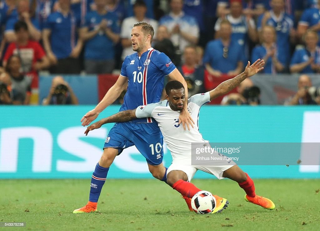 NICE, June 28, 2016-- Gylfi Sigurdsson, left, of Iceland vies with Danny Rose of England during their Euro 2016 round of 16 football match in Nice, France, June 27, 2016.