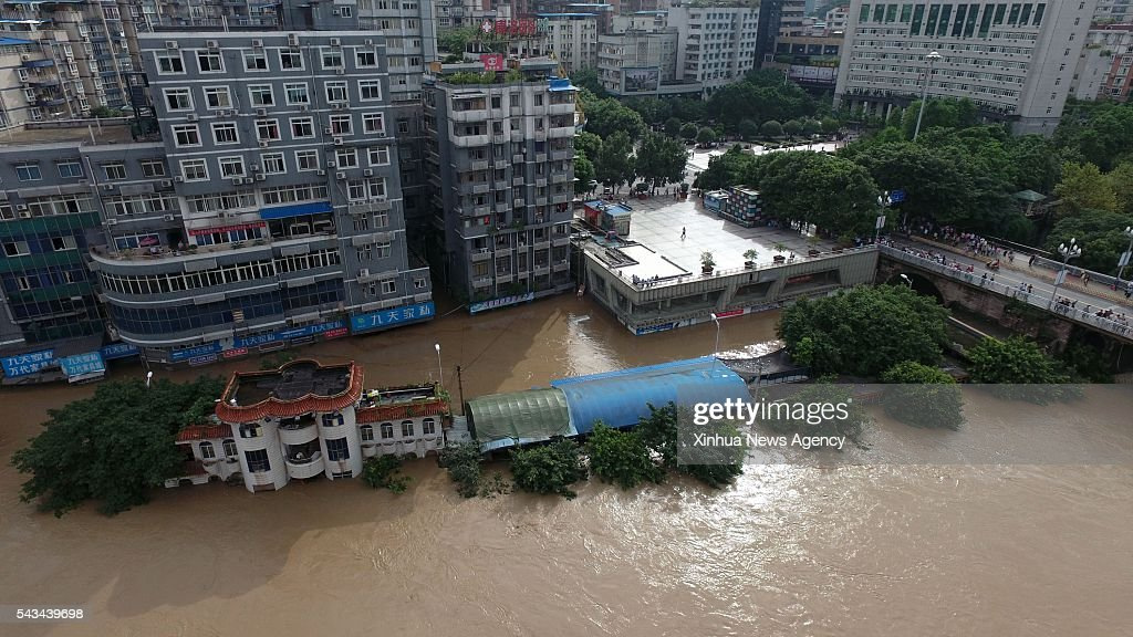 CHONGQING, June 28, 2016 -- Photo taken on June 28, 2016 shows flood in the Qijiang District of Chongqing, southwest China. Torrential rain hit Qijiang District from night of Monday to noon on Tuesday, which caused a leap of water level to 224.7 meters, two meters higher than the safety level.