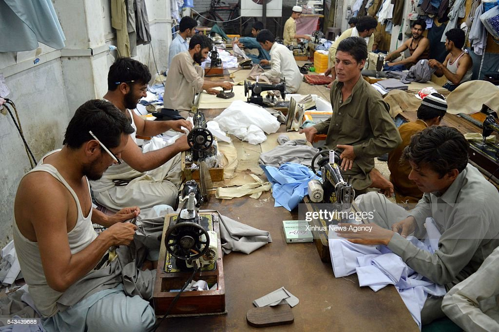 PESHAWAR, June 28, 2016 -- Tailors stitch clothes for the upcoming Eid al-Fitr festival in northwest Pakistan's Peshawar, June 28, 2016. Muslims around the world prepare to celebrate the Eid al-Fitr festival, which marks the end of the holy month of Ramadan.