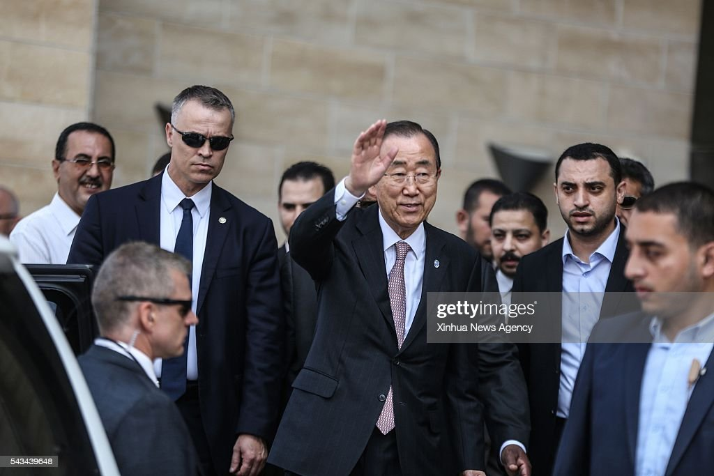 CITY, June 28, 2016 -- United Nations Secretary General Ban Ki-moon, center, waves to the media as he arrives to visit a Qatari-funded rehabilitation and artificial limbs hospital in Gaza City, June 28, 2016. United Nations Secretary General Ban Ki-moon on Tuesday called for ending the Israeli blockade on the Gaza Strip and described it as 'collective punishment.'