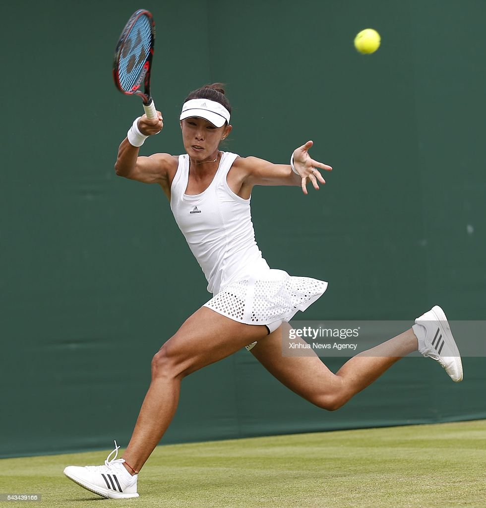 LONDON, June 28, 2016 -- Wang Qiang of China returns the ball against Daria Gavrilova of Australia during a women's singles first round match of 2016 Wimbledon Championships in Wimbledon, southwest London, June 28, 2016. Gavrilova won 2-1.