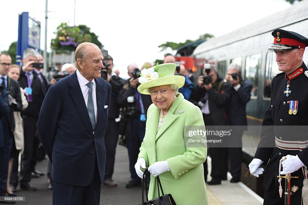 Queen <a gi-track='captionPersonalityLinkClicked' href=/galleries/search?phrase=Elizabeth+II&family=editorial&specificpeople=67226 ng-click='$event.stopPropagation()'>Elizabeth II</a> and <a gi-track='captionPersonalityLinkClicked' href=/galleries/search?phrase=Prince+Philip&family=editorial&specificpeople=92394 ng-click='$event.stopPropagation()'>Prince Philip</a>, Duke Of Edinburgh arrive by steam train to open the new Bellarena Station village on June 28, 2016 in Bellarena, Northern Ireland.