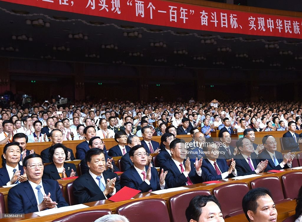 BEIJING, June 29, 2016 -- Chinese President Xi Jinping and other senior leaders Li Keqiang, Zhang Dejiang, Yu Zhengsheng, Liu Yunshan, Wang Qishan and Zhang Gaoli join an audience of more than 3,000 at the concert 'Eternal Faith' marking the 95th anniversary of the founding of the Communist Party of China at the Great Hall of the People in Beijing, capital of China, June 29, 2016.