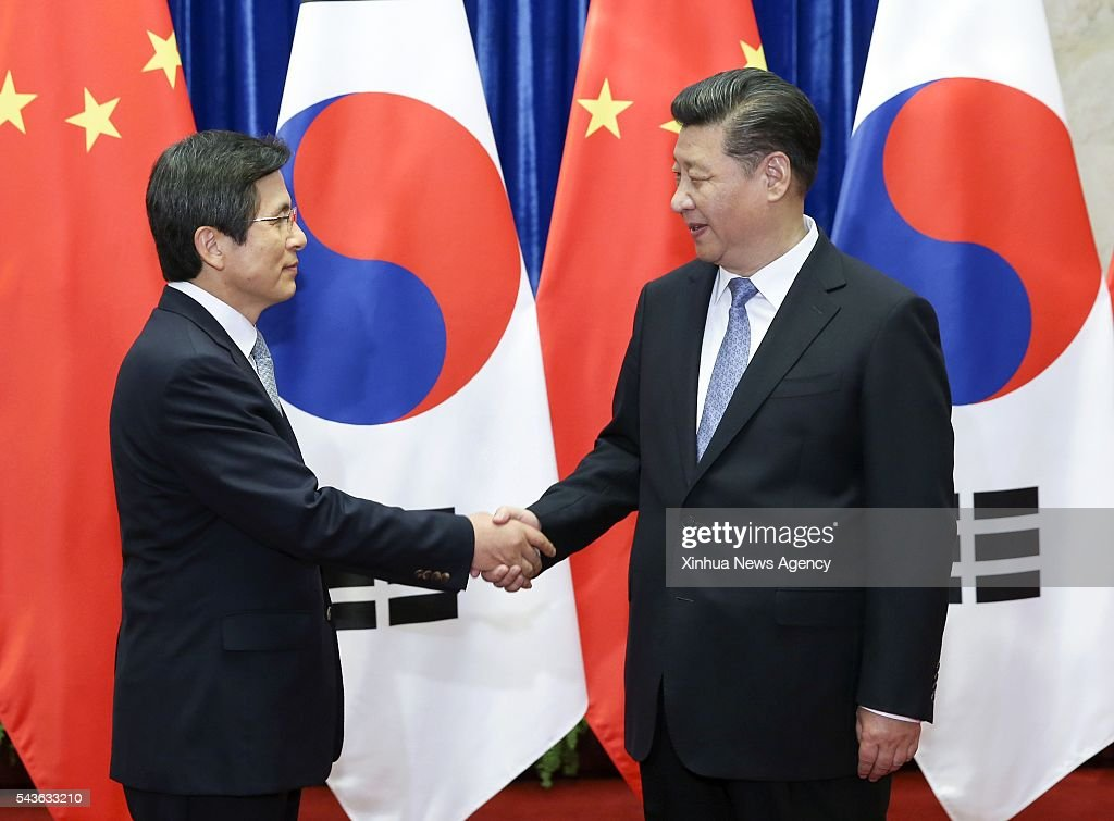 BEIJING, June 29, 2016-- Chinese President Xi Jinping, right, meets with the Republic of Korea Prime Minister Hwang Kyo-ahn in Beijing, capital of China, June 29, 2016.