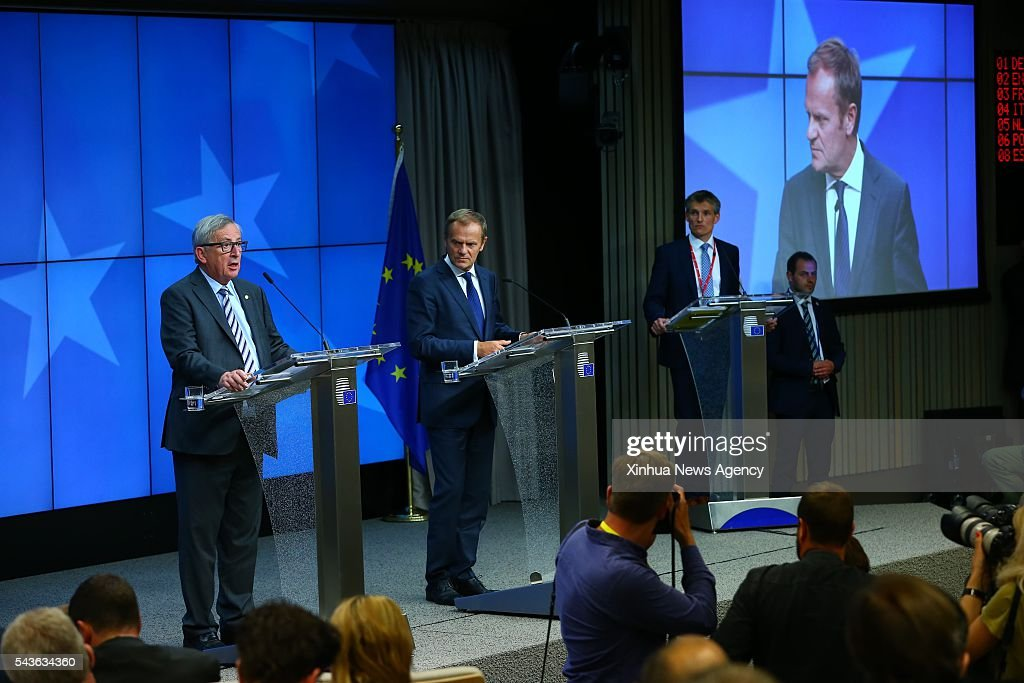 BRUSSELS, June 29, 2016-- European Council President Donald Tusk, center, and European Commission President Jean-Claude Juncker, left, attend a press conference at the EU headquarters in Brussels, Belgium, June 29, 2016. European Council President Donald Tusk said on Wednesday that leaders of the 27 non-UK European Union countries have agreed that they would not grant Britain access to the block's single market if Britain did not accept EU's rules on free movement.