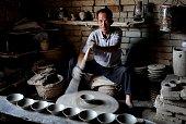 CHENGCHENG June 29 2016 Folk artist Zhou Tiehuai makes rough porcelain bowls in the Yaotou Kiln tourist zone in Yaotou Township of Chengcheng County...