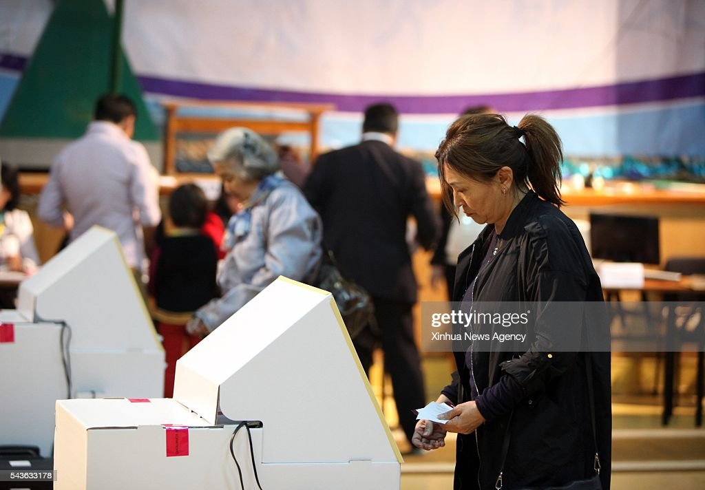 BATOR, June 29, 2016 -- Mongolian voters cast their votes for the parliamentary elections at a polling station in Ulan Bator, Mongolia, June 29, 2016. Mongolians voted on Wednesday for a new parliament. According to the General Election Commission of Mongolia, 498 candidates, coming from 12 parties, three coalitions or as independents, will run for 76 seats of the State Great Khural, as well as posts in local law-making councils.