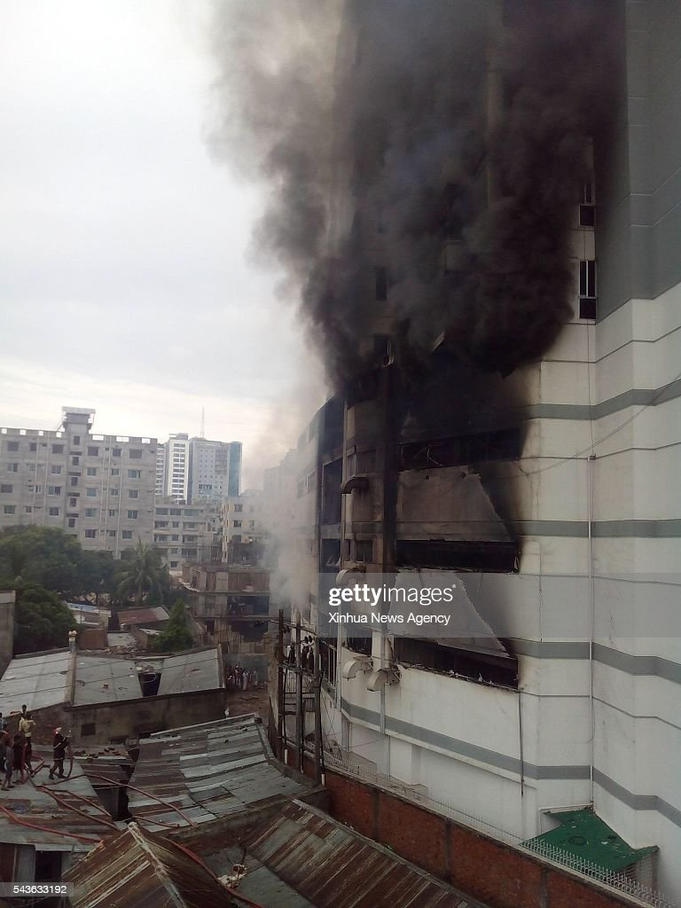 DHAKA, June 29, 2016-- Photo taken on June 29, 2016 shows heavy smoke from a fire at a residential multi-story building at Uttar Badda in Dhaka, Bangladesh.