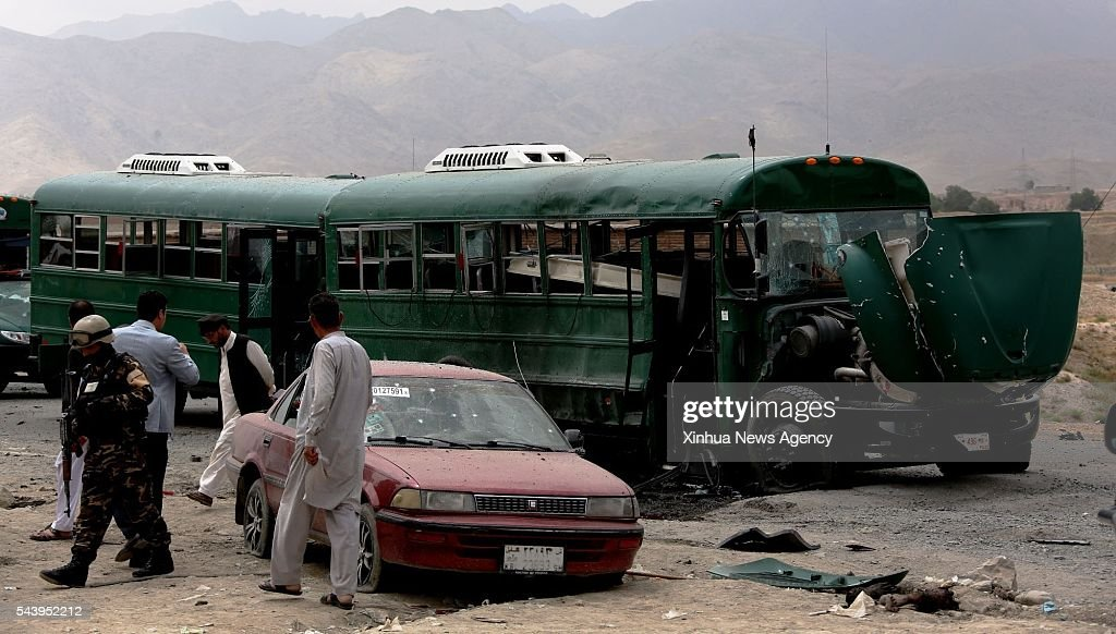 KABUL, June 30, 2016-- Afghan security force inspect the site of a suicide attack in Kabul, Afghanistan, June 30, 2016. Two suicide explosions hit Afghan police convey of five buses in the western part of Kabul on Thursday, leaving at least 30 people dead, sources said.