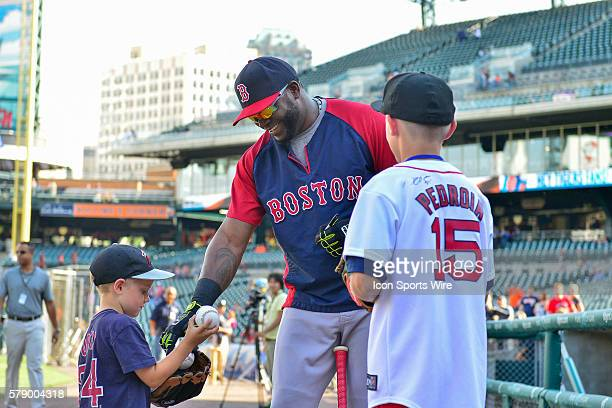 June 6 2014 Detroit MI Boston Red Sox designated hitter David Ortiz signs autographs for a couple of young fans during batting practice prior to the...