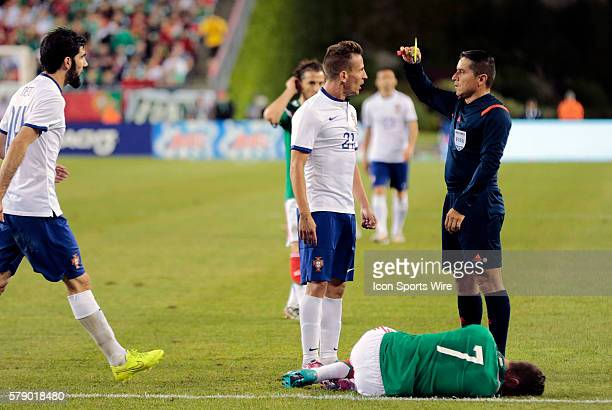 Portugal's Joao Pereira questions his yellow card from Referee Jeffrey Solis after fouling Mexico's Miguel Layun The men's national team of Portugal...