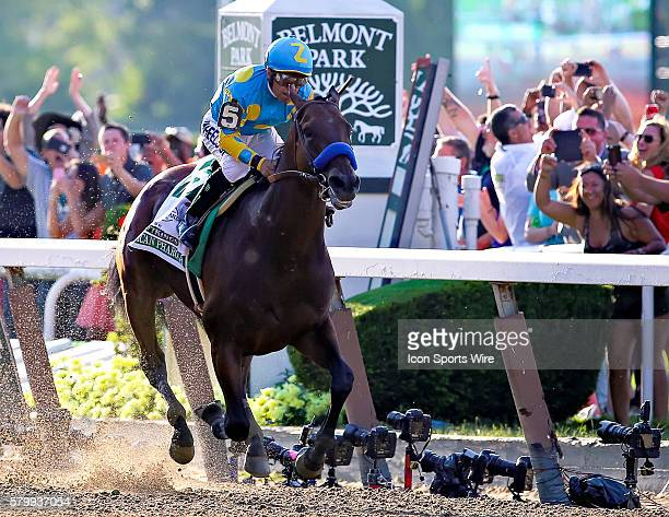 American Pharoah crosses the finish line to win the 147th running of the Belmont Stakes and with it Thoroughbred Racing's elusive Triple Crown at...