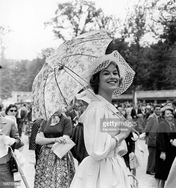 June 7 Many Elegant Spectators Such As The Model Daniele Saintoin Wearing A WideBrimmed Hat In Thick Tulle Attending The Prix De Diane At The...