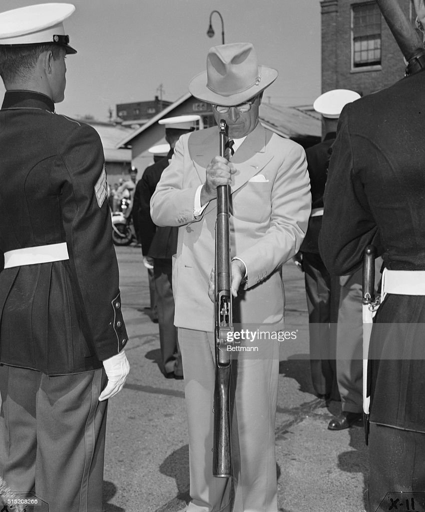 June 9 1948 Bremerton Washington President Truman looks into the barrel of a Grand rifle during an inspection of Marine troops in Bremerton...