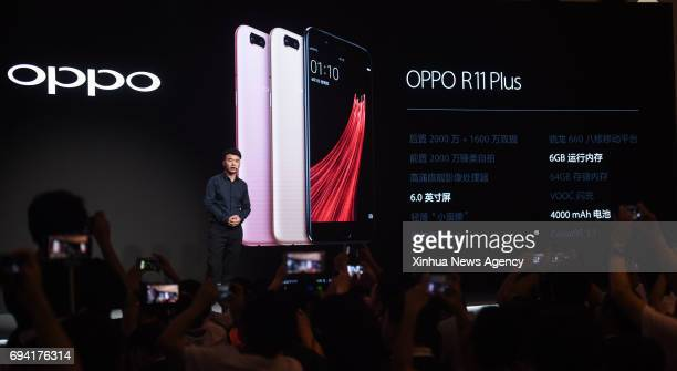 OPPO smartphone R11 is newly released at a press conference in Shenzhen south China's Guangdong Province June 9 2017 The new smartphone is featured...