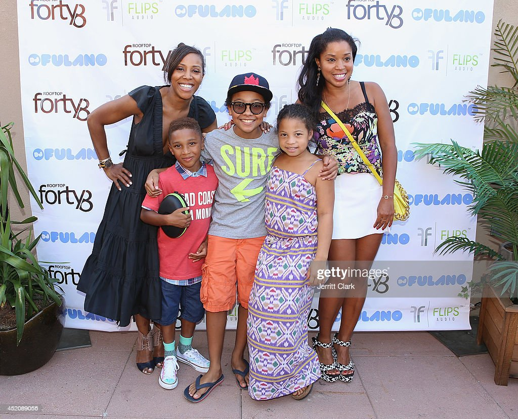 <a gi-track='captionPersonalityLinkClicked' href=/galleries/search?phrase=June+Ambrose&family=editorial&specificpeople=619410 ng-click='$event.stopPropagation()'>June Ambrose</a> and <a gi-track='captionPersonalityLinkClicked' href=/galleries/search?phrase=Mashonda&family=editorial&specificpeople=673897 ng-click='$event.stopPropagation()'>Mashonda</a> pose with their kids at DJ Fulano's 11th birthday party at Rooftop 48 on July 12, 2014 in New York City.