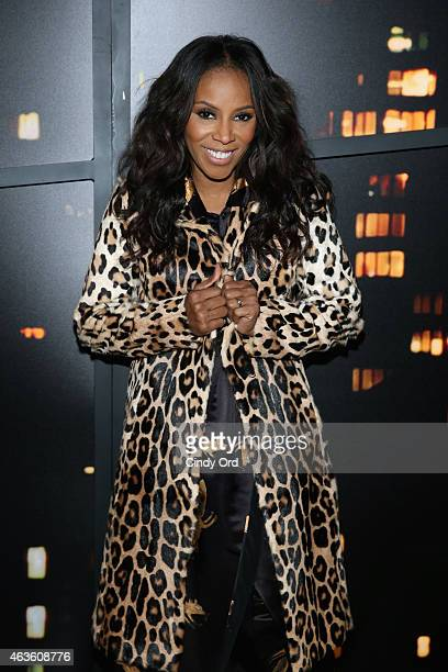 June Ambrose attends the Donna Karan New York fashion show during MercedesBenz Fashion Week Fall 2015 on February 16 2015 in New York City