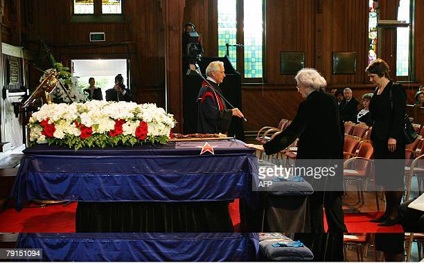 June Lady Hillary touches the coffin of her husband Sir Edmund Hillary as New Zealand Prime Minster Helen Clark pays her respects in Auckland 22...