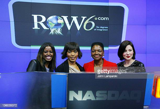 June Sarpong Angela Bassett Baroness Valerie Amos and Lynn Collins ring the NASDAQ stock market closing bell on December 20 2011 in New York City