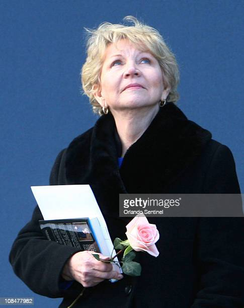 June Scobee Rodgers widow of Dick Scobee commander of space shuttle Challenger looks to the sky Friday January 28 2011 during the playing of the...