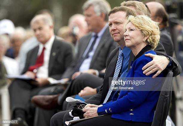 June Scobee Rogers widow of Challenger commander Dick Scobee and her son Lt Col Richard Scobee listen to speakers during a memorial service on the...