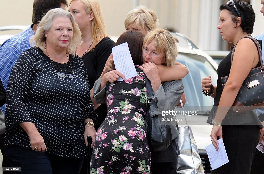 June Steenkamp, Reeva's mother, is comforted as she arrives at Reeva's memorial on February 19, 2013 in Port Elizabeth, South Africa. Steenkamp was allegedly murdered by boyfriend, Oscar Pistorius on February 14, 2013. Pistorius, who has been charged with the murder, is appearing in court today for his bail hearing. Steenkamp's memorial is being held at The Victoria Park Crematorium.