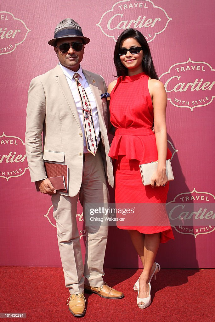 Junelia Aguiar (R) & Ash Chandler (L) pose for pictures during Cartier 'Travel With Style' Concours 2013 at Taj Lands End on February 10, 2013 in Mumbai, India.