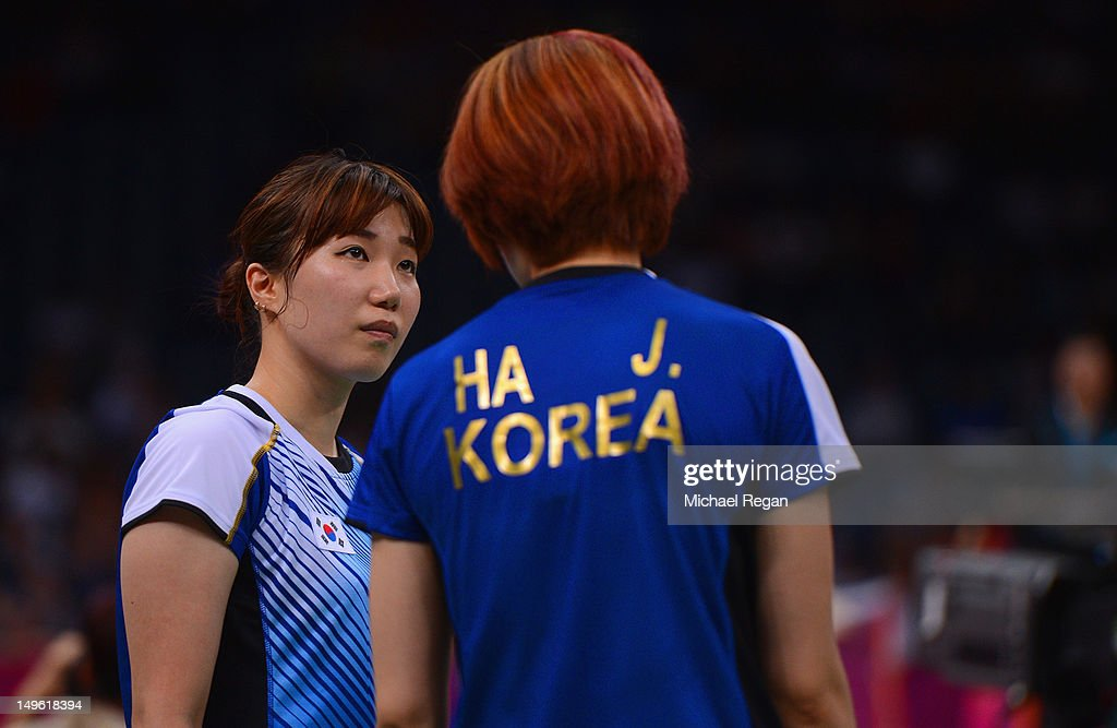 Jung Eun Ha and Min Jung Kim of Korea look on against Greysia Polii and Meiliana Jauhari of Indonesia in their Women's Doubles Badminton on Day 4 of the London 2012 Olympic Games at Wembley Arena on July 31, 2012 in London, England.