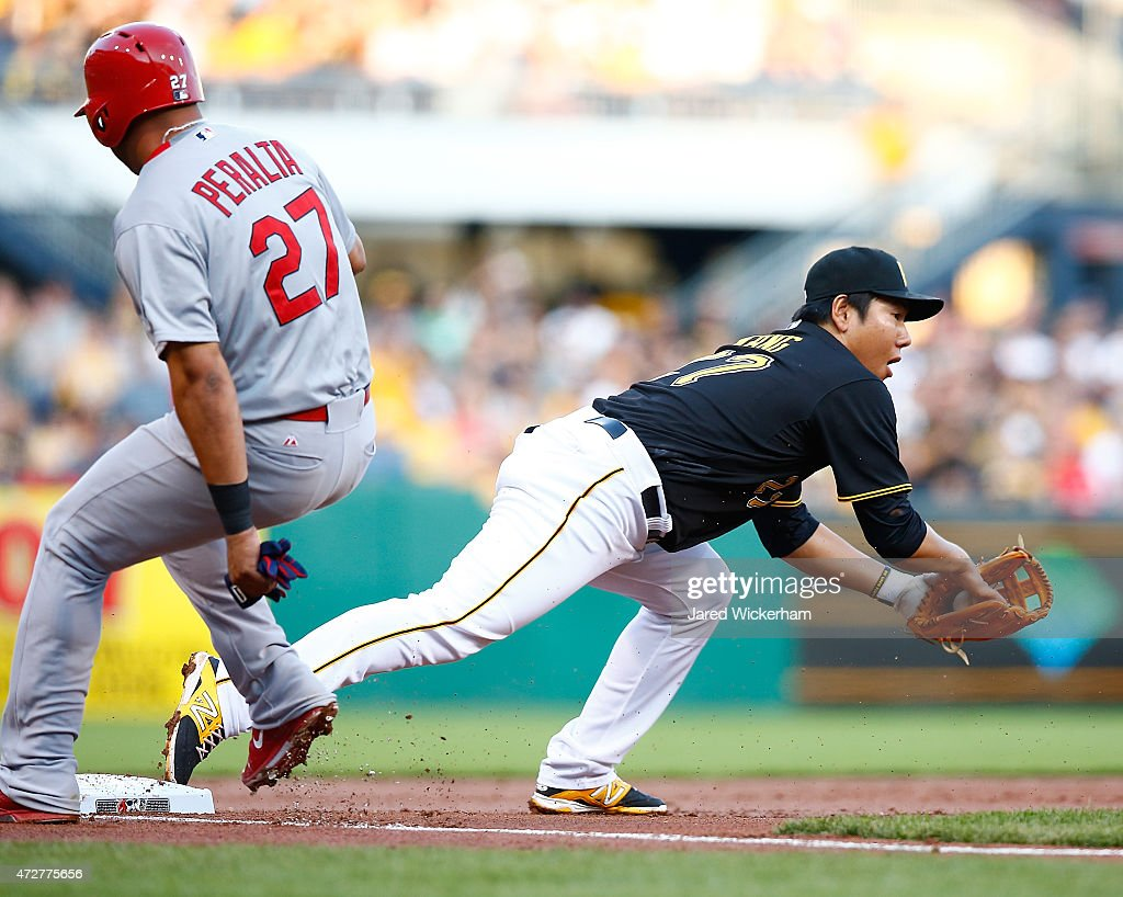 Jung Ho Kang #27 of the Pittsburgh Pirates catches the second of three outs at third base to force the out on Jhonny Peralta #27 of the St Louis Cardinals on a triple play in the top of the second inning of the St Louis Cardinals during the game at PNC Park on May 9, 2015 in Pittsburgh, Pennsylvania.