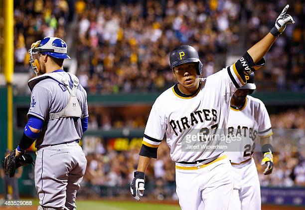 Jung Ho Kang of the Pittsburgh Pirates celebrates his three run home run in the 7th inning against the Los Angeles Dodgers during the game at PNC...