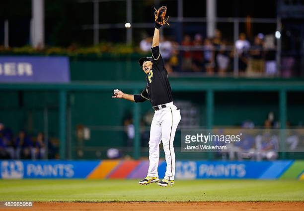 Jung Ho Kang of the Pittsburgh Pirates reaches but is unable to come up with the catch in the 8th inning against the Chicago Cubs during the game at...