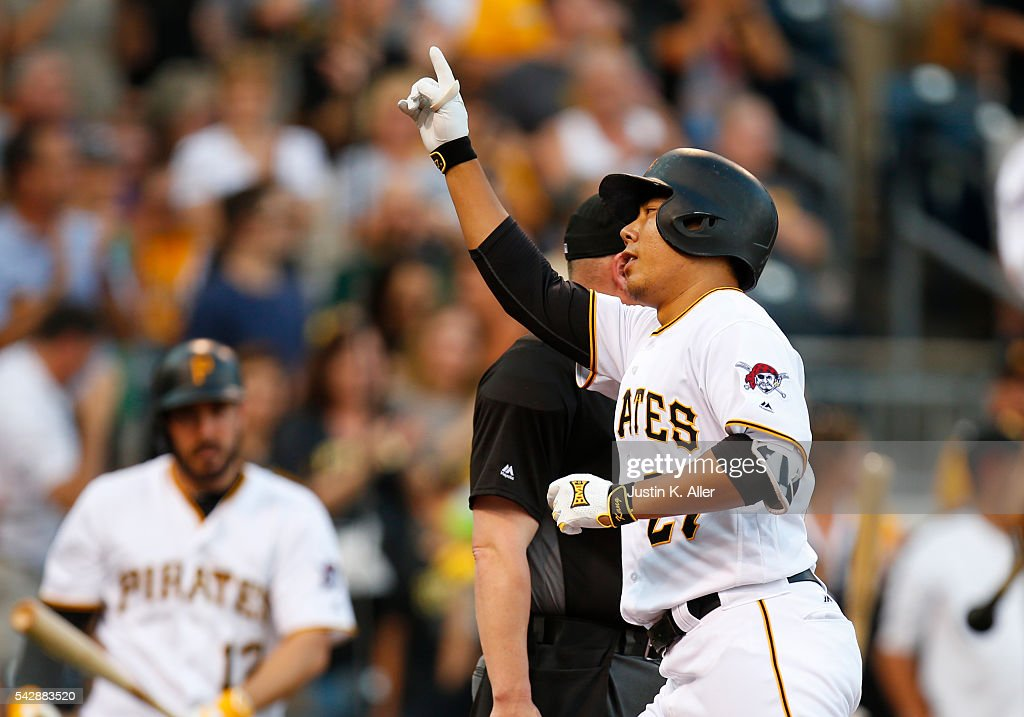 Jung Ho Kang #27 of the Pittsburgh Pirates reacts after hitting a home run in the third inning during the game against the Los Angeles Dodgers at PNC Park on June 24, 2016 in Pittsburgh, Pennsylvania.