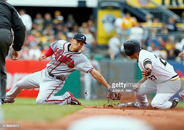 Jung Ho Kang of the Pittsburgh Pirates steals second base in the first inning against Andrelton Simmons of the Atlanta Braves during the game at PNC...