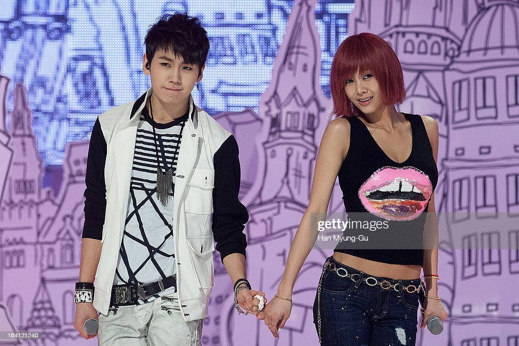 Jung Il-Hoon of South Korean boy band BtoB and singer G.NA perform onstage during the MBC Music 'Show Champion' at Uniqlo-AX Hall on March 20, 2013 in Seoul, South Korea.