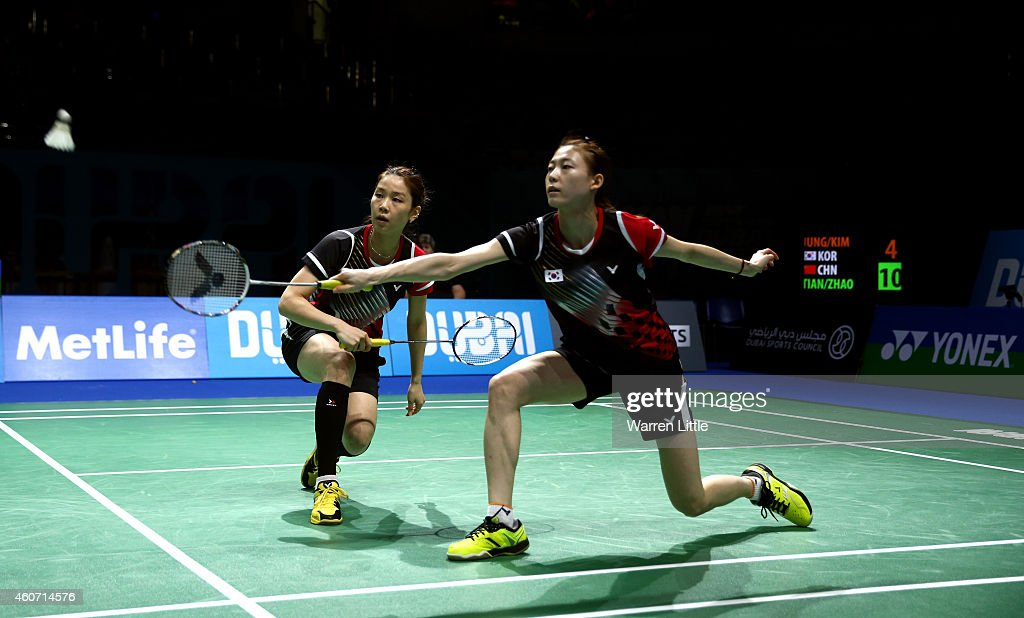 Jung Kyung Eun and Kim Ha Na of Korea in action against Tian Qing and <a gi-track='captionPersonalityLinkClicked' href=/galleries/search?phrase=Zhao+Yunlei&family=editorial&specificpeople=5534160 ng-click='$event.stopPropagation()'>Zhao Yunlei</a> of China during the Women's Doubles match on day four of the BWF Destination Dubai World Superseries Finals at the Hamdan Sports Complex 20, 2014 in Dubai, United Arab Emirates.