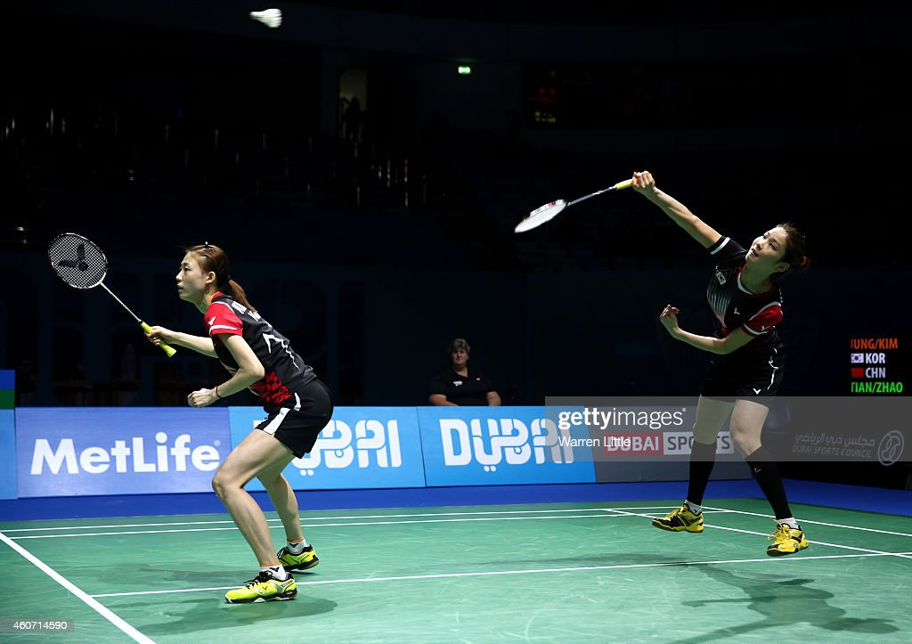 Jung Kyung Eun and Kim Ha Na of Korea in action against <a gi-track='captionPersonalityLinkClicked' href=/galleries/search?phrase=Tian+Qing&family=editorial&specificpeople=2296575 ng-click='$event.stopPropagation()'>Tian Qing</a> and <a gi-track='captionPersonalityLinkClicked' href=/galleries/search?phrase=Zhao+Yunlei&family=editorial&specificpeople=5534160 ng-click='$event.stopPropagation()'>Zhao Yunlei</a> of China during the Women's Doubles match on day four of the BWF Destination Dubai World Superseries Finals at the Hamdan Sports Complex 20, 2014 in Dubai, United Arab Emirates.