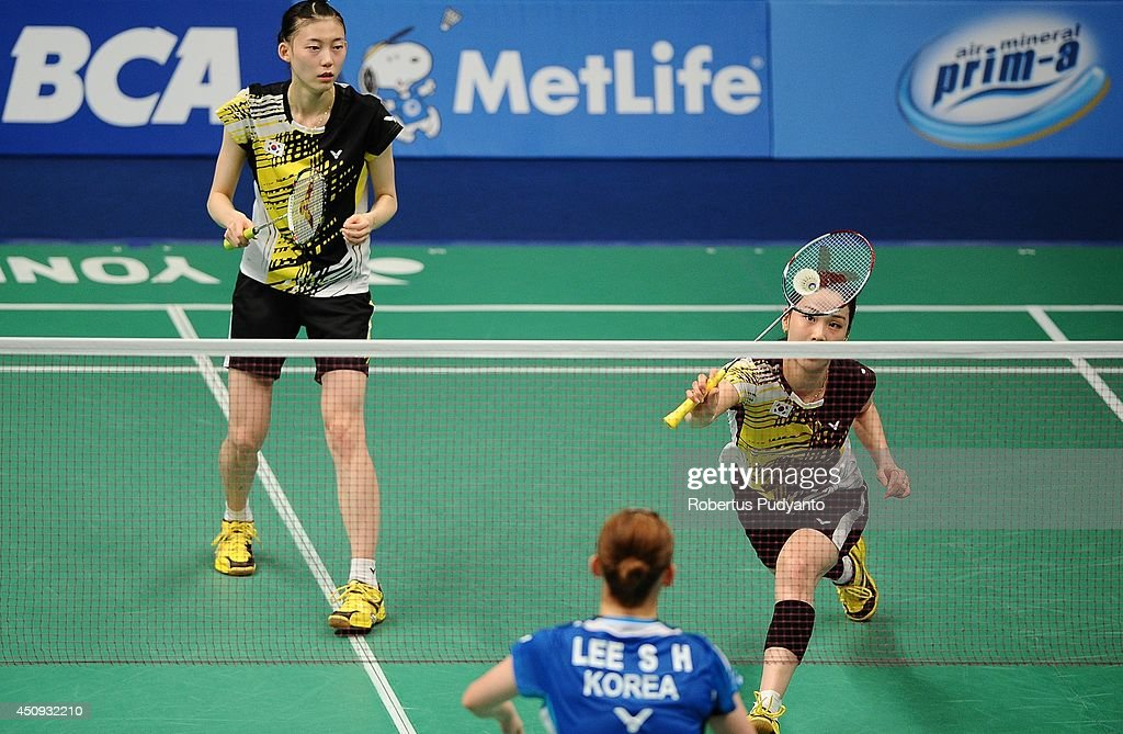 Jung Kyung Eun and Kim Ha Na of Korea return a shot against Lee So Hee and Shin Seung Chan of Korea during the BCA Indonesia Open 2014 MetLife BWF World Super Series Premier at Istora Gelora Bung Karno Stadium on June 20, 2014 in Jakarta, Indonesia.