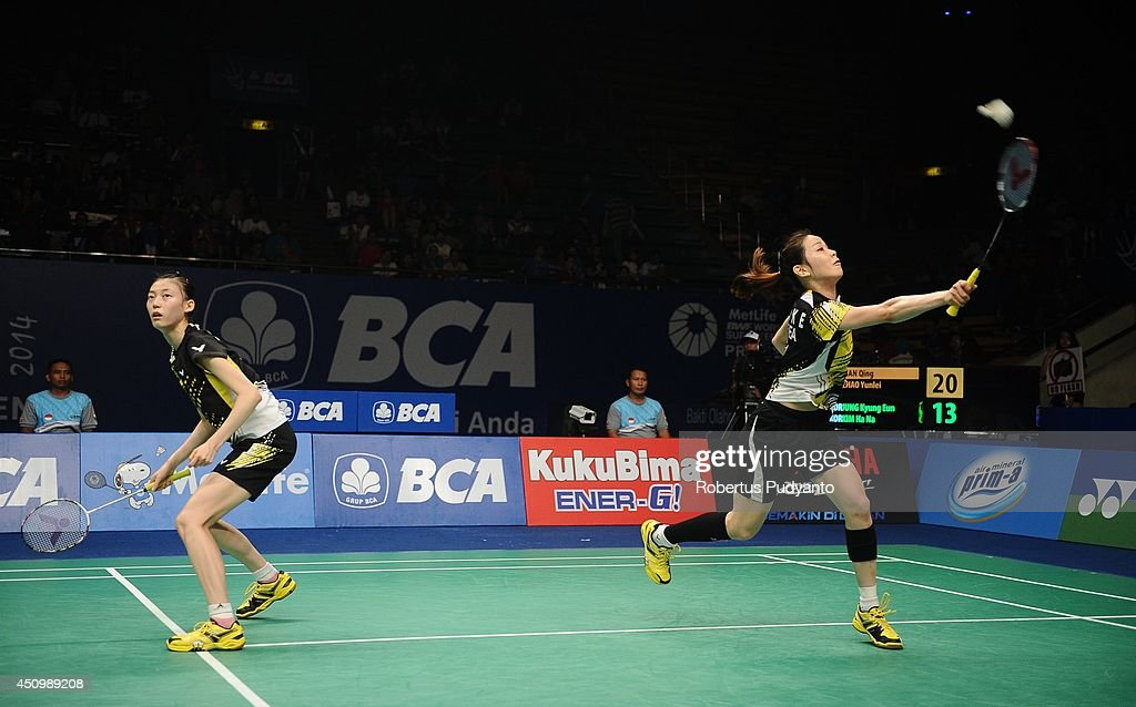 Jung Kyung Eun and Kim Ha Na of Korea return a shot against Tian Qing and Zhao Yunlei of China during the semifinal BCA Indonesia Open 2014 MetLife BWF World Super Series Premier at Istora Gelora Bung Karno Stadium on June 21, 2014 in Jakarta, Indonesia.