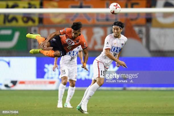 Jung Seung Hyun of Sagan Tosu and Mateus of Omiya Ardija compete for the ball during the JLeague J1 match between Sagan Tosu and Omiya Ardija at Best...