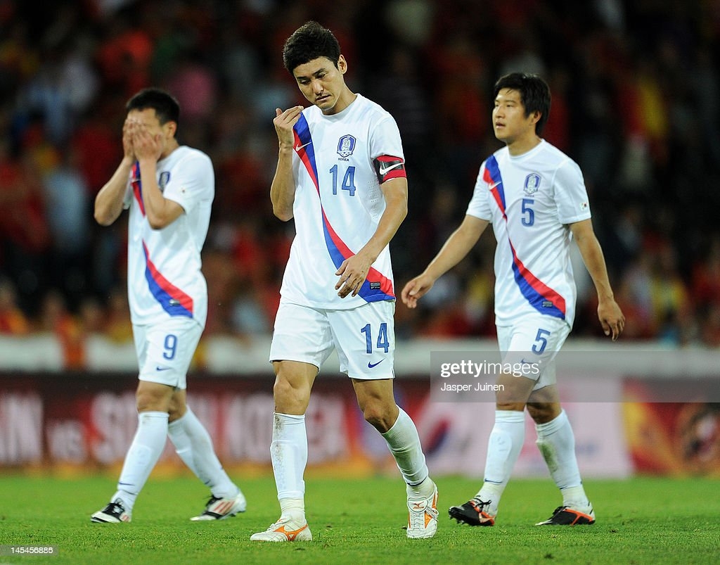 Jung Soo Lee (C) of Korea Republic trudges off the pitch with his teammates Joo Ho Park (R) and Chi Woo Kim at the end of the international friendly match between Spain and Korea Republic on May 30, 2012 in Bern, Switzerland.