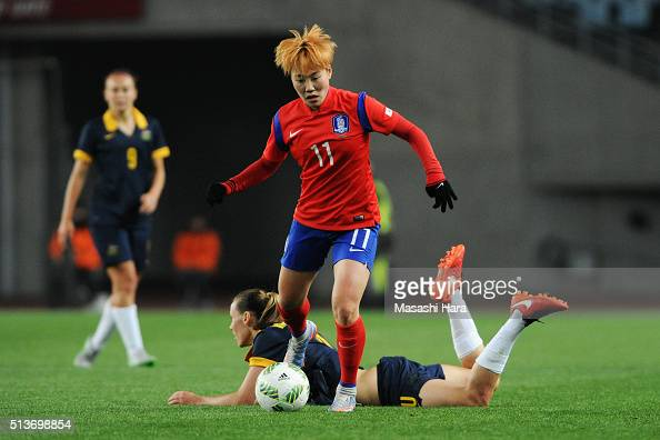 Jung Sul Bin of South Korea and Emily van Egmond of Australia compete for the ball during the AFC Women's Olympic Final Qualification Round match...