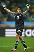 Jung SungRyong of South Korea celebrates Park ChuYoung goal from a free kick during the 2010 FIFA World Cup South Africa Group B match between...