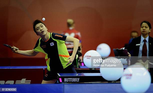 Jung Youngsik of Korea Republic competes against Tang Peng of Hong Kong during the 2016 World Table Tennis Championship Men's Team Division Round 5...