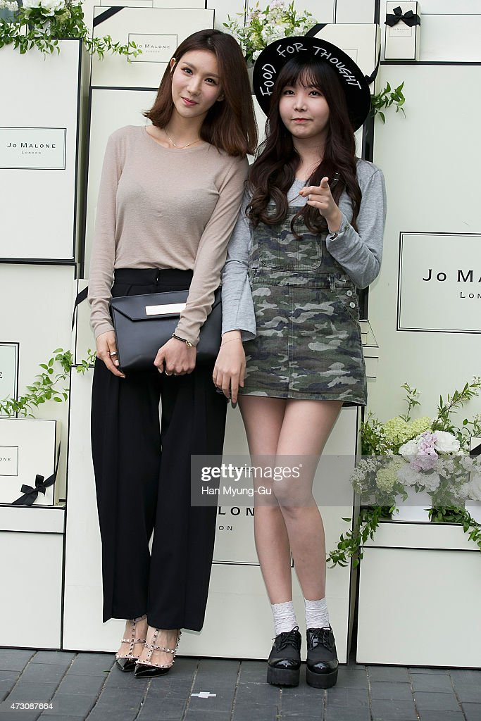 Jung-A and Raina of South Korean girl group After School attend the photocall for Jo Malone London Hannam boutique opening on May 12, 2015 in Seoul, South Korea.