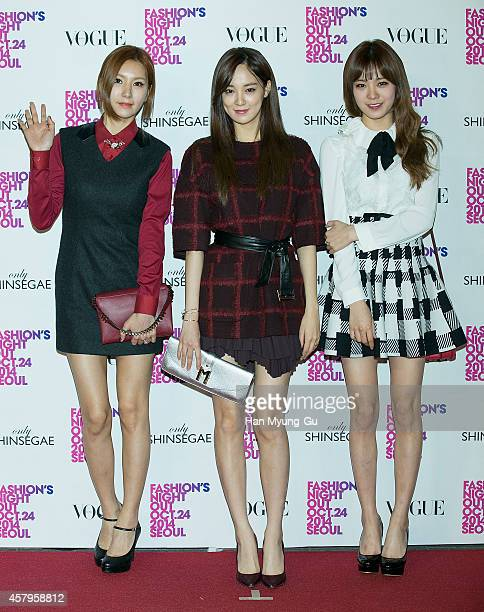 JungA Juyeon and Lizzy of South Korean girl group After School attend 'Vogue Fashion's Night Out' at Shinsegae Department Store on October 24 2014 in...