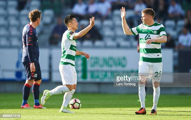 JungBin Park and Soren Frederiksen of Viborg FF celebrate after scoring their first goal during the Danish Alka Superliga match between Viborg FF and...