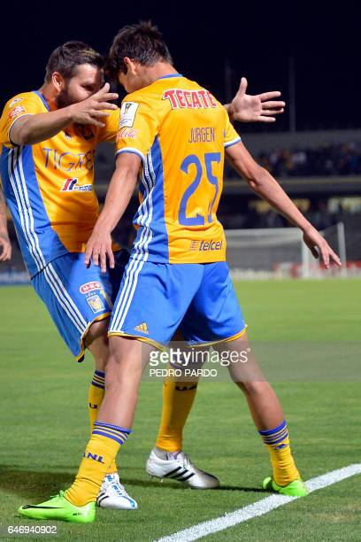 Jungen Damm of Mexico´s Tigres celebrates with his teammate Andre Pierre Gignac his goal against Mexico´s Pumas during the second leg quarterfinal of...