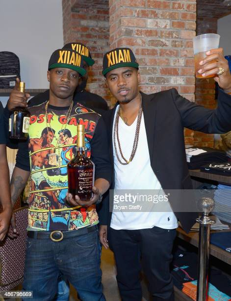 Jungle and rapper Nas celebrate the opening of 12amRun shoe store at The LINQ on April 25 2014 in Las Vegas Nevada
