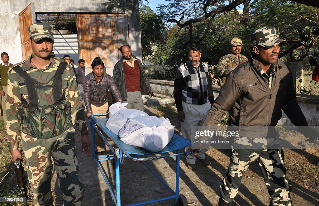 Jungle warrior Cobra Commandos taking the dead body of CRPF jawans after post mortem at RIMS on January 10, 2013 in Ranchi, India. The naxals had surgically inserted improvised Explosive Device in the body of the slain jawan of the Central Reserve Police Force who was killed three days back in an ambush in Jharkhand's Latehar district.