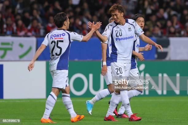 Jungo Fujimoto of Gamba Osaka celebrates scoring the opening goal with his team mate Shun Nagasawa during the JLeague J1 match between Consadole...